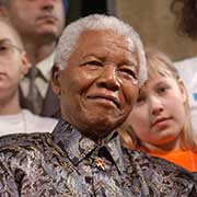 Nelson Mandela is surrounded by children at a United Nations children's forum