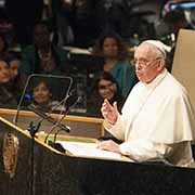 Pope Francis gestures while addressing the United Nations.