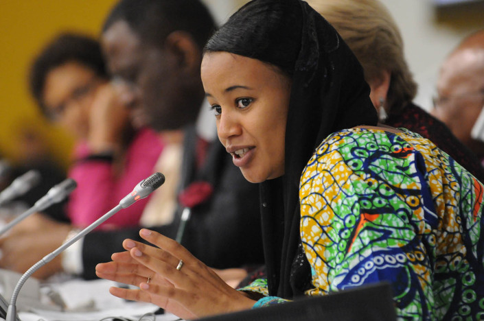 Nigerian youth activist Salamatou AghaliIssoufa, 22, wearing a black head scarf, addresses the UN on ending child marriage.