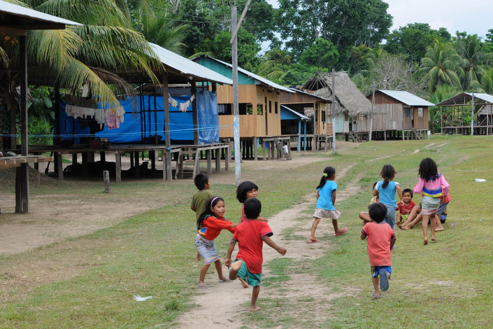 "A group of children play ""tag"" in the indigenous Shipibo-Conibo community of Nuevo Saposoa in the Peruvian Amazon."