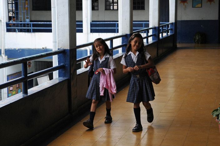 Girls walk through the hallways of a school in Medellín, Colombia.