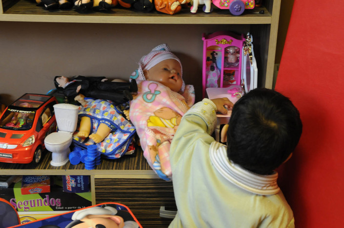 A toddler plays with toys in a psychosocial center in Guatemala.