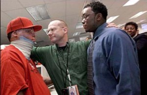 Star-Ledger Photographer Matt Rainey (center) embraces (L-R) Alvaro Llanos and Shawn Simons, after winning the 2000 Pulitzer Prize in Feature Photography for a story about the two Seton Hall students who recovered from a fire in their dorm. Photo by Saed Hindash/The Star-Ledger