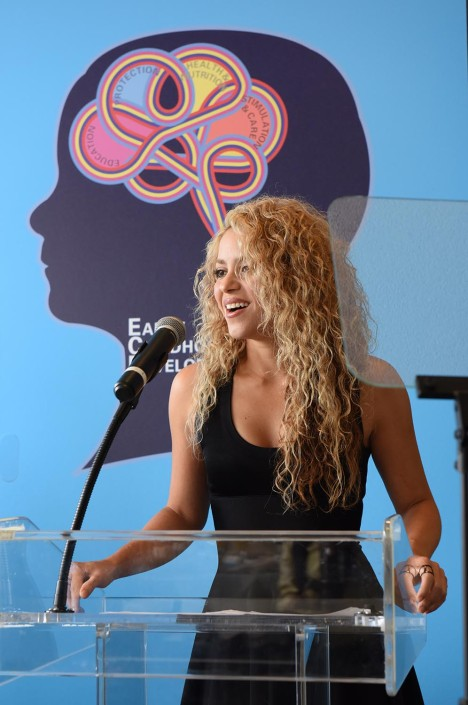 Shakira speaks at a podium at a United Nations event.