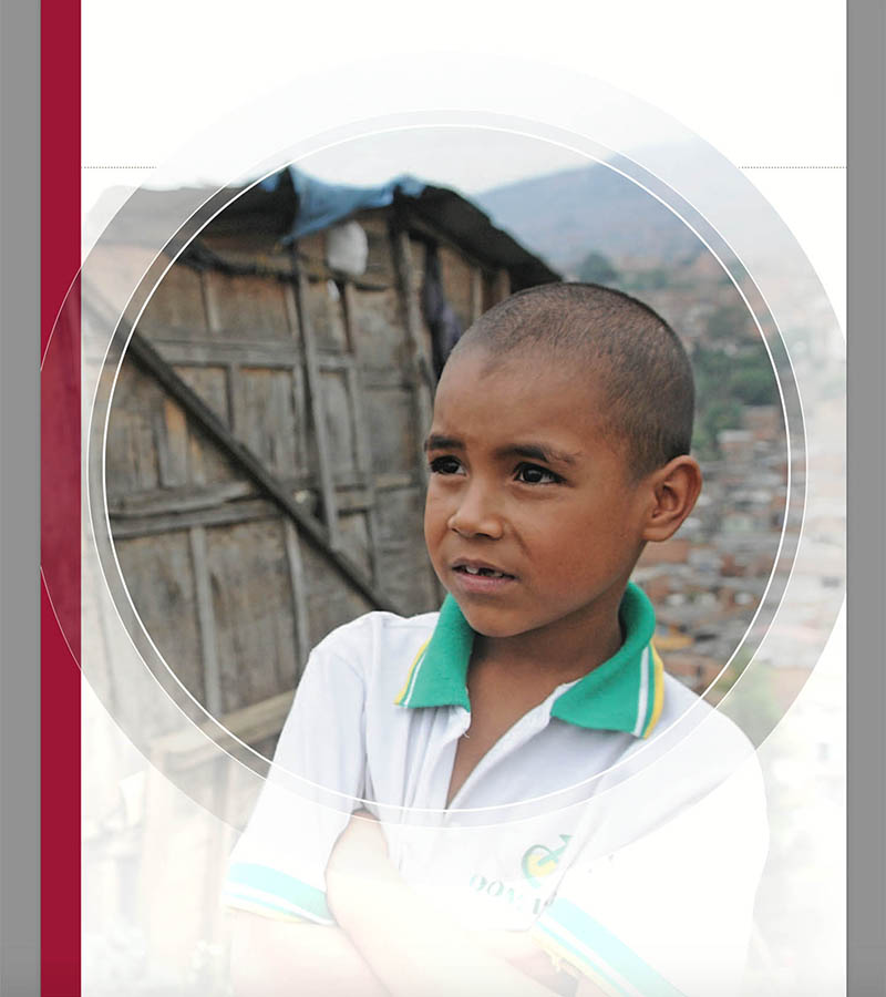 Screen capture of Watchlist report showing a photograph of a young boy next to his house on a toxic landfill in Medellin, Colombia.