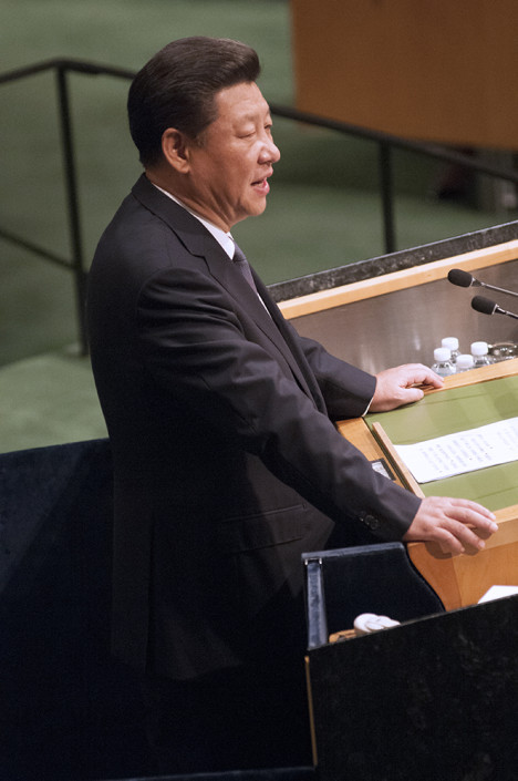 Chinese President Xi Jinping stands at the podium as he addresses diplomats in the UN General Assembly.