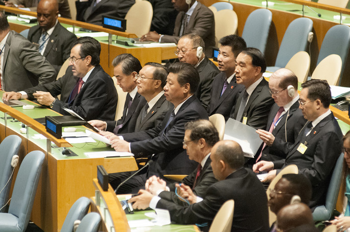 Chinese President Xi Jinping sits with his country's large delegation at the United Nations.