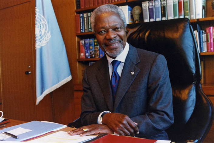 A smiling UN Secretary-General Kofi Annan sits in his office at UN headquarters following the 2011 Nobel Peace Prize announcement.