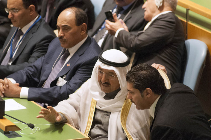The Amir of Kuwait consults with a colleague in the UN General Assembly.