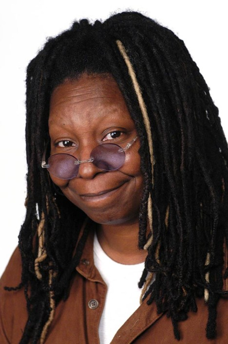 Portrait of American actress and UNICEF Goodwill Ambassador Whoopi Goldberg, wearing sunglasses.